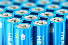 Makrosikt av gruppen av blåa alkaliska motorförbundetbatterier Fotografering för Bildbyråer
