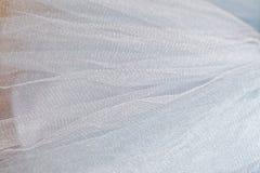 Makrosikt av sömnadklänningar Slut upp av tygingreppet för ballerinakjol Kjol för dans för barn` s Netto brölloptextil arkivfoto
