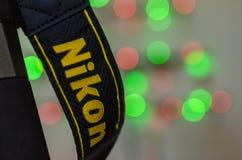 Makroskott av den Nikon kameraremmen Arkivbilder