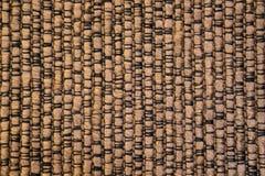 Makroskott av guld- brunt tyg med band och handlag av blac arkivbilder