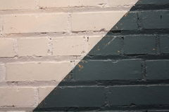 Makroskottet av vit- och gräsplanblått målade tegelstenväggen Fotografering för Bildbyråer