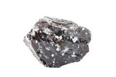 Makroskytte av den naturliga gemstonen Den rå mineralen är obsidian, Indonesien Anmärka på en vitbakgrund Royaltyfri Fotografi