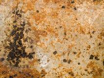 Makrotextur - metall - rostig skalningsmålarfärg arkivfoton