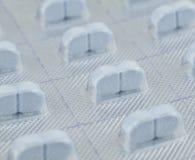 Makrotrieb der blauen Pille lizenzfreie stockfotos