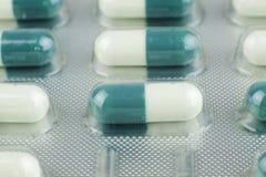 Makrotrieb der grünen Pillen Lizenzfreies Stockbild