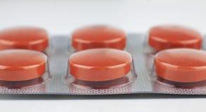 Makrotrieb der orange Pille stockbild