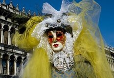 The Maks. Woman wearing mask and costume in Venice,Italy at St. Marks Square for Carnivale Royalty Free Stock Photos