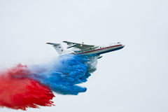 MAKS-2009 Be-200. Aerospace Show MAKS-2009. Moscow, 18-23 august 2009. Fire hydroplane Beriev 200 throwing down water how Russian flag Royalty Free Stock Photos