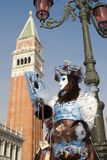 Maks from venice carnival and bell-tower Stock Photo