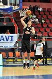 Maksym Pustozvonov jumping with the ball to the basket Stock Photography