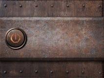 Maktknapp på rostig metalltextur som ångapunkrock Royaltyfri Bild