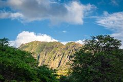 Makua beach view with beatiful mountains and cloudy sky in the background, Oahu island. Hawaii stock photo