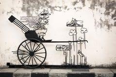 MALÁSIA, PENANG, GEORGETOWN - CERCA DO JULHO DE 2014: Sinal artístico, wi Fotos de Stock Royalty Free
