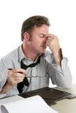 Mal de tête au travail image libre de droits