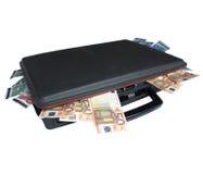 Mala de viagem com dinheiro Imagens de Stock Royalty Free