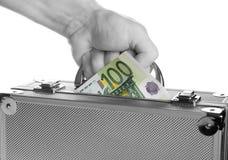 Mala de viagem com dinheiro Imagem de Stock Royalty Free