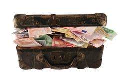 Mala de viagem completamente do dinheiro Fotografia de Stock Royalty Free