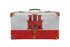 Mala de viagem do vintage com bandeira de Gibraltar Fotografia de Stock