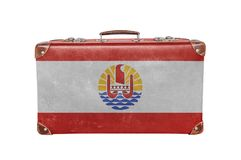 Mala de viagem do vintage com a bandeira de Polinésia francesa Fotos de Stock