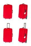 Mala de viagem vermelha com o Tag em branco sobre o branco. Jogo Foto de Stock Royalty Free