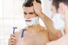 Mala máquina de afeitar Foto de archivo libre de regalías