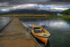 Mala Prespa lake and the pier of Mikrolimni village Royalty Free Stock Photos