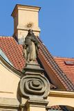 Detail of a religious sculpture in Mala Strana district, Prague. Mala Strana developed at the foot of Prague`s Castle Hill, a cluster of noble homes and palaces Stock Images