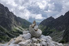Mala studena dolina hiking trail in High Tatras, summer touristic season, wild nature, touristic trail, stone cairn. On viewpoint, heavy clouds Royalty Free Stock Image
