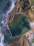 Malabar Rock pool. Solo morning swimmer at Malabar rock pool, Sydney, Australia Royalty Free Stock Photo