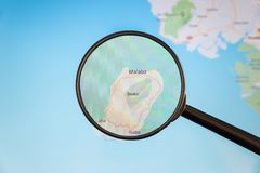 Malabo, Equatorial Guinea. Political map. City visualization illustrative concept on display screen through magnifying glass royalty free stock image
