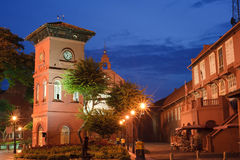 Malacca landmark. Stadthuys Square, with clock tower and old red house in night in Malaysia, Asia stock photography