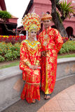 Malacca Malay Couple. MALACCA, MALAYSIA - JANUARY 1: A Malay bride and groom in their traditional Malacca Malay costume on JAN 1, 2012 in MALACCA, MALAYSIA. The royalty free stock photos