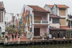 Malacca, Malaysia - circa September 2015: Riverside promenade with historical houses along Sungai Melaka, Malacca,  Malaysia Royalty Free Stock Images