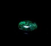 Malachite Cabochon. Polished malachite cabochon isolated over black background Royalty Free Stock Photos