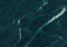 Malachite deep green natural grunge marble texture, detailed structure. Of natural marble background stock photography