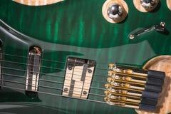 Malachite green electric guitar. strings Royalty Free Stock Photos