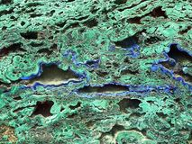 Malachite mineral stone texture for background. Rock abstract photo. geological gem stock photography