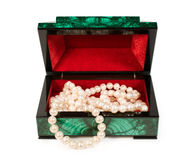 Malachite  treasure-box with a pearl necklace Stock Photography