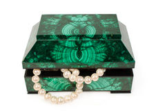 Malachite  treasure-box with a pearl necklace Stock Photo