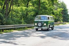 MALACKY, SLOVAKIA – JUNE 2 2018: Volkswagen Microbus takes part in the run during the veteran car rally Kamenak 2018 at the. Kamenny mlyn roadhouse stock photos