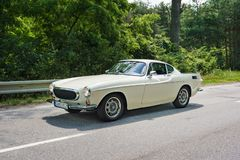 MALACKY, SLOVAKIA – JUNE 2 2018: Volvo P1800 S Coupe takes part in the run during the veteran car rally Kamenak 2018 at the. Kamenny mlyn roadhouse royalty free stock image
