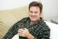 Malade à la maison - liquides photographie stock