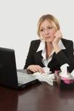 Malade au travail Image libre de droits