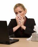 Malade au travail Photo stock