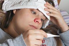 Malade de fille dans le bâti Photos stock