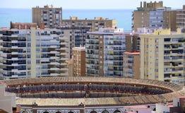 Malaga bullring with apartments and mediteranean sea Royalty Free Stock Images