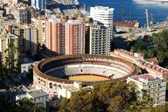 Malaga bullring and port. Royalty Free Stock Photos