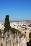 Malaga castle battlements and city buildings. Royalty Free Stock Image