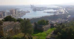 Malaga day light city gibralfaro castle bay and port view 4k stock footage