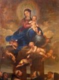 Malaga - den Madonna (oskulden av radbandet) målningen av Alonso Cano från 17 cent i domkyrka Arkivbilder